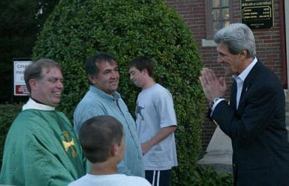 Democratic presidential candidate Sen. John Kerry (news - web sites), D-Mass., right, greets Father Cannon, left, Francis Flaherty, second from left, and Flaherty's son Anthony, 12, foreground, after attending mass at Chapel of Our Lady of Good Voyage in Boston, on Sunday, June 27, 2004. Kerry canceled plans to address the 72nd Annual Meeting of the U.S. Conference of Mayors on Monday which is likely to be picketed by police officers. (AP Photo/Jeff Chiu)